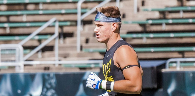 Who are Oregon's options at tight end outside Jacob Breeland?
