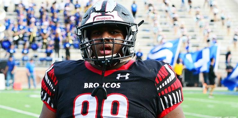 Arkansas makes defensive tackle's top three