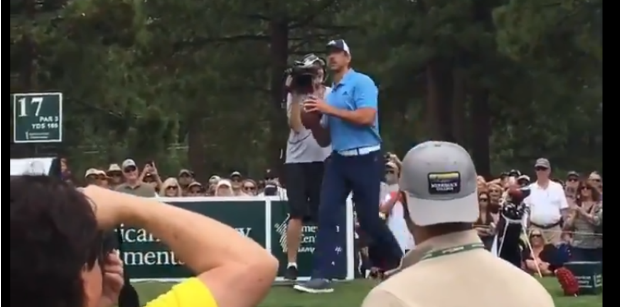 Aaron Rodgers shows off arm at golf event