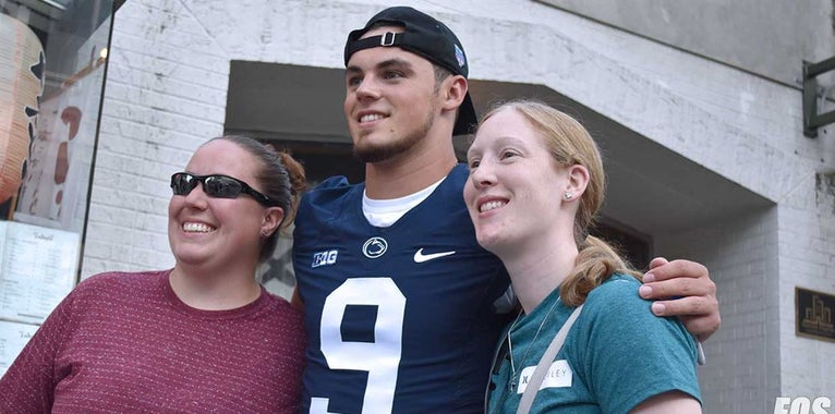 Penn State football players tackle Arts Fest crowd